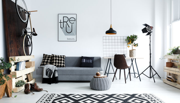 Hipster style, white living room with sofa, pouf, carpet, bike